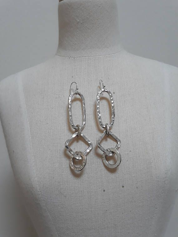 Beaten sterling silver earrings.