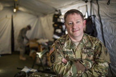Sean Siler, DO, MBA, clinical assistant professor of emergency medicine at the UNC School of Medicine and Colonel in the U.S. Army Reserves, led medical operations at the annual Operation Toy Drop at Fort Bragg, an event that trains paratroopers and benefits children in need.