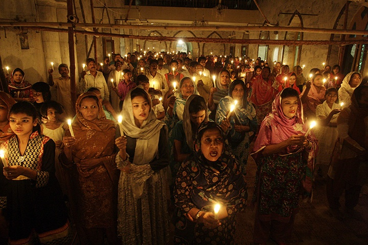 Easter in Lahore, Pakistan: Christians hold candles during an Easter vigil mass