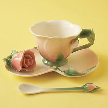 Two's Company Rose Tea Set: Two's Company Rose Tea Set. A delicately sculpted saucer and matching cup in a deep rose shade with a sprinkling of blossoms in handpainted porcelain. What better way to celebrate tea time. Three piece set includes teacup, saucer and spoon. 5 1/2