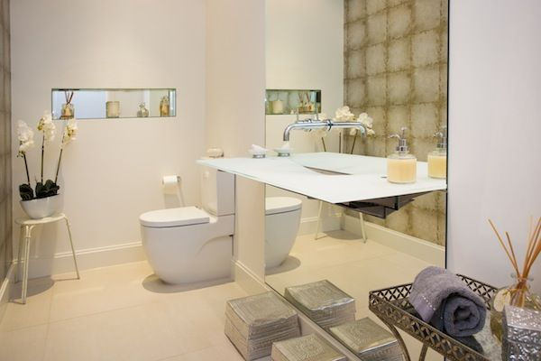 We love the use of a 'floating' vanity in this chic bathroom.