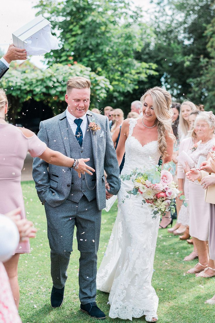 Confetti Moment | Bride in Lace Enzoani 'Inaru' Bridal Gown | Groom in Grey Wool Master Debonair Suit | Pink & Coral Country Wedding at Crabbs Barn, Essex | Kathryn Hopkins Photography | Film by Colbridge Media Services Ltd