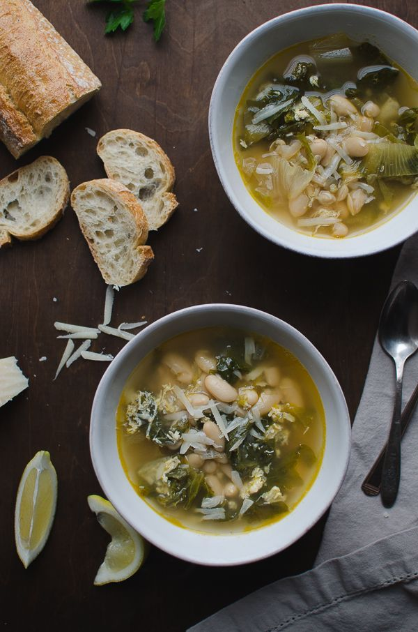 Escarole and Cannellini Bean Soup in Parmesan Broth - this recipe is amazing! Escarole and cannellini beans simmered in a light Parmesan broth then topped off with some lemon and more Parmesan. | /tasteLUVnourish/