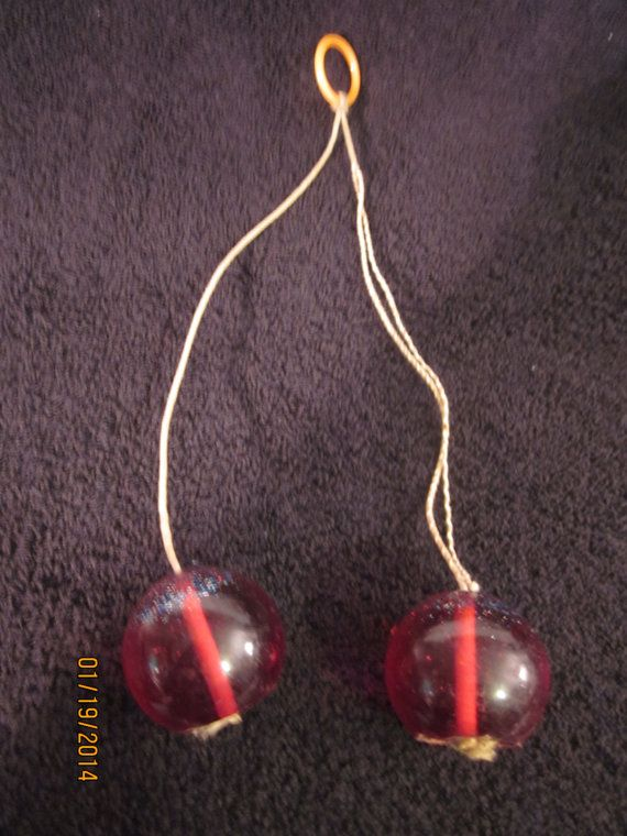 Vintage 1970's toy Clackers.  Rumor had it if you let them hit too hard they'd explode.  Did we try??  Of course!!