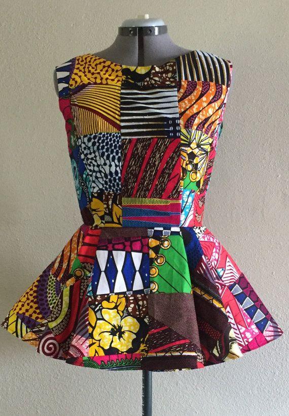 Cera africana sin mangas impresos Patchwork Peplum por WithFlare