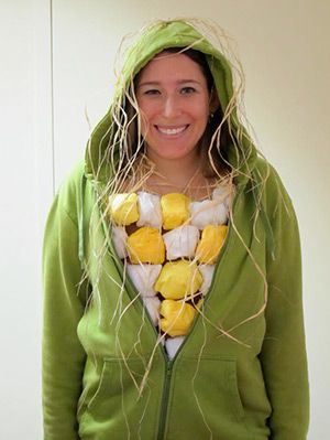 "Wear a green sweatsuit, and make the top by glueing yellow and white tissue paper ""corns"" all over a white top. Add some straw to the top of your hoodie, and you're officially corn on the cob."