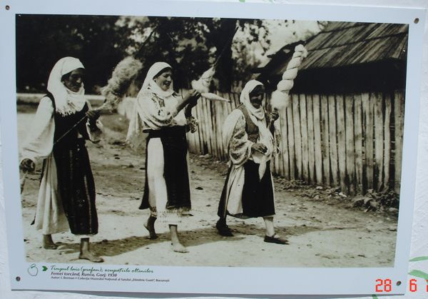 Three ladies in different stages of spinning.