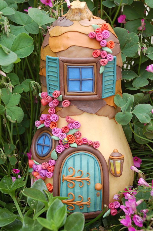 Modeling clay + gourd = Amazing fairy garden house! DIY steps --> http://www.hgtvgardens.com/crafts/make-a-magical-forest-fairy-house?soc=pinterest