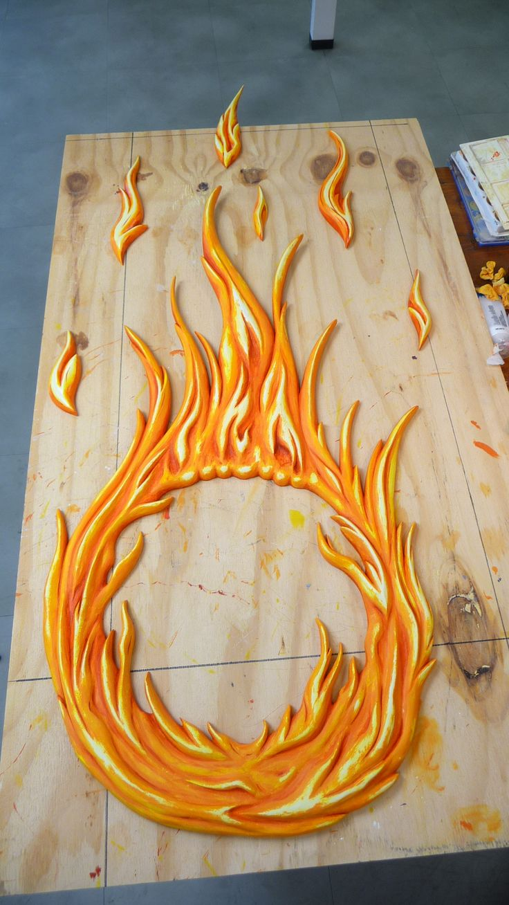 NEW FLAME: Finally we add in the dark red and touch up the top parts with a yellow and very light ornage shade to enhance the flames...