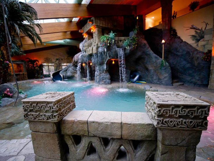 One of the home's most distinctive spaces is this indoor swimming pool, complete with waterfalls. This spectacular indoor oasis incorporates Mayan-ruin replicas and is illuminated by natural daylight from a glass ceiling supported by massive wood beams.