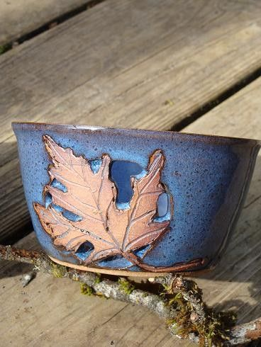 Cut-out leaf candle holders. $12.00, via Etsy.