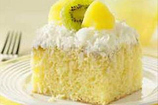 Made with a cake mix, this yellow cake is infused with warm milk and coconut then frosted with coconut-laced whipped topping for a dreamy dessert.