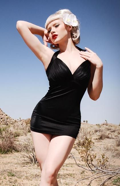 """The Bombshell Swimsuit in Black by Pinup Couture - The """"Bombshell"""" by Pinup Couture is a vintageinspired one piece swimsuit made of high quality, shiny swimtech fabric.  Taken from Old Hollywood style swimsuits, the Bombshell has a padded bust with a pleated overlay, with a thick elastic band for bust support.  The front of the suit is lined with a strong powermesh panel to smooth the tummy.  Feel like a true 1950s Hollywood starlet in this amazing vintage reproduction swimsuit!"""