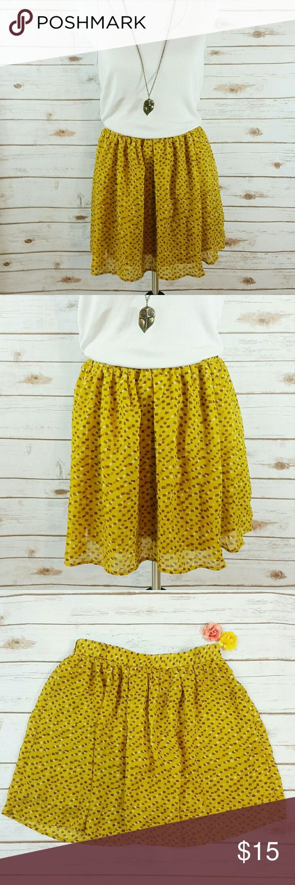 "Mossimo mustard yellow patterned skirt This mustard yellow skirt has a pattern of squares and circles that are yellows, browns, and tans. The waist is elastic in the back, and has belt loops. Waist is approx 26"", length is approx 17"". All measurements taken unstretched. 100% polyester Mossimo Supply Co. Skirts Midi"