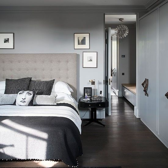Tonal grey bedroom with dark wood floor. This tonal grey bedroom is a homage to Italian designer Piero Fornasetti. Set against white walls it could look harsh, but grey makes the scheme easier on the eye. #Sleeptember