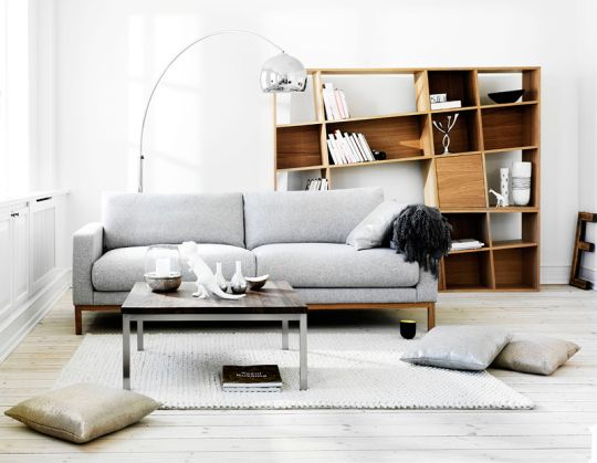 the art of the balance - the couch + lamp perfectly complement this slanted statement bookshelf