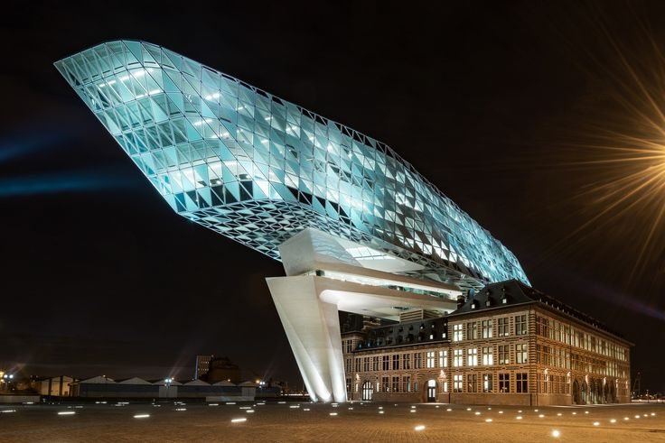Sparkle! - The Port House is the headquarters of the port authority of Antwerp, the architect is Zaha Hadid who deceased shortly after the delivery of the building. The impressive new structure is in symbiosis with an old fire station. The sparkling glass fronts gives the perception of a diamond and refers to the city of Antwerp, one of the major trade centres of diamond.