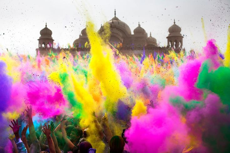 Thousands throw colored powder in sequence every 2 hours during the Holi Festival of Colors, on Saturday, Mar. 24, 2012, at the Lotus Temple in Spanish Fork, Utah.