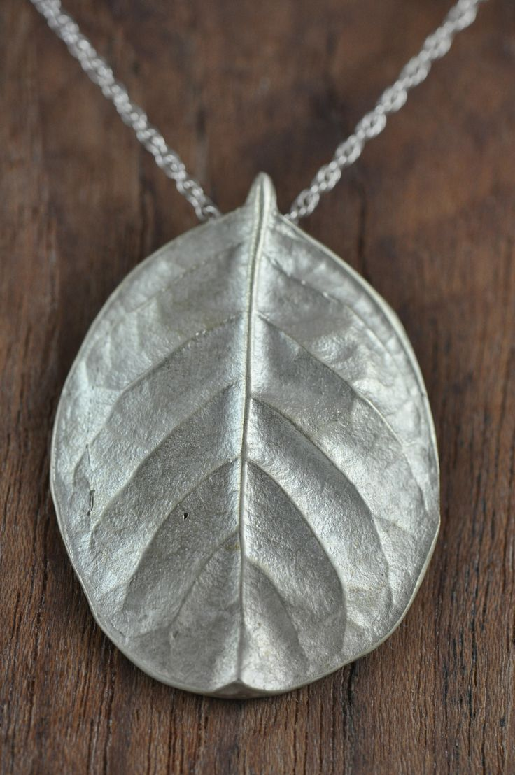 Bright large sterling silver salal pendant. Salal, a symbol of prosperity, boasts a beautiful leaf that has been captured here in its complete pureness. $185