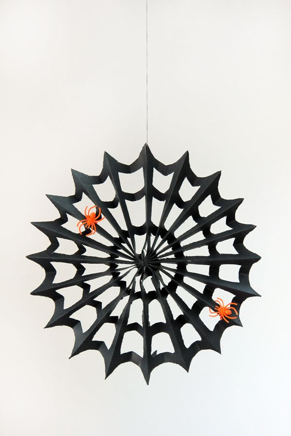 diy not a paper snowflake but a spider web heres a tutorial for this super easy spider web decoration made from scrapbook paper scissors and glue - How To Make Paper Halloween Decorations