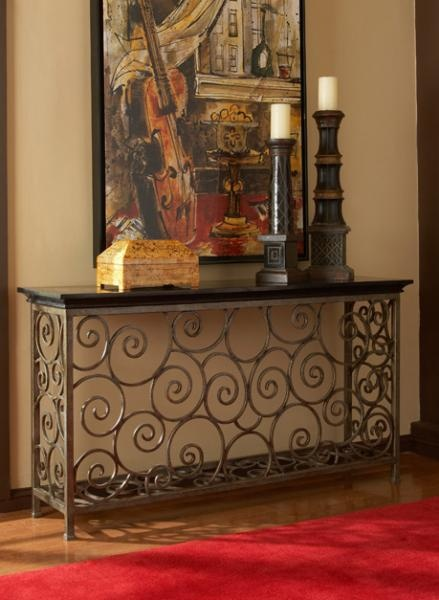 Scrolling wrought iron console table complete with a fossil stone top. $1,750