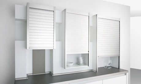 Tambour kitchen- rolling shutters can cover shelves or cabinets for clean but accessible storage.