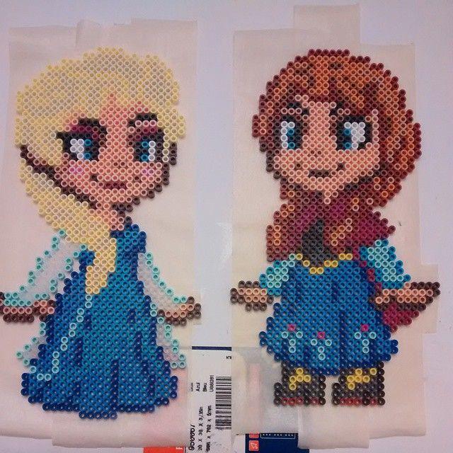 Elsa and Anna - Frozen perler bead sprites by nicknitro81 (original bead sprite design by GeekMythologyCraft)