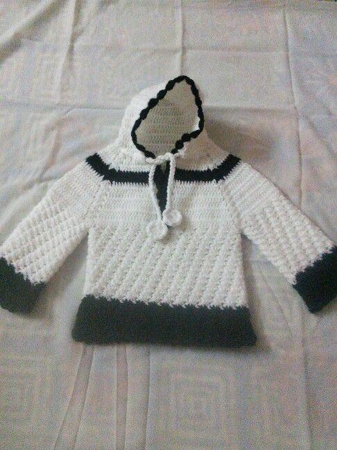 Crochet jacket with cap.