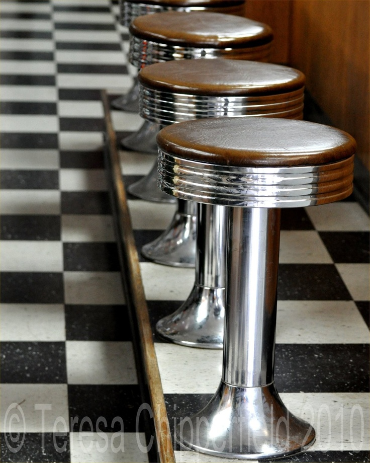 This is a photograph of Vintage Bar Stools at the Counter of an old fashioned Diner