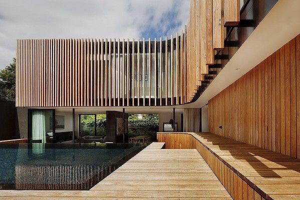 Vertical cladding allows water to run off this Matt Gibson-designed house in Kooyong