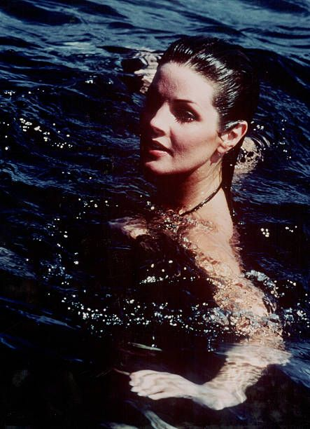 American Actress Priscilla Presley swimming in the sea circa 19821988