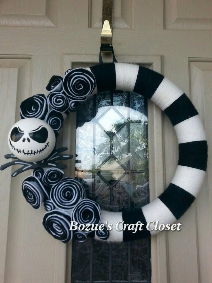 Jack Skellington wreath, Nightmare Before Christmas wreath, black and white yarn wreath, Halloween wreath, Christmas wreath, holiday wreath by BozuesCraftCloset on Etsy https://www.etsy.com/listing/229186880/jack-skellington-wreath-nightmare-before