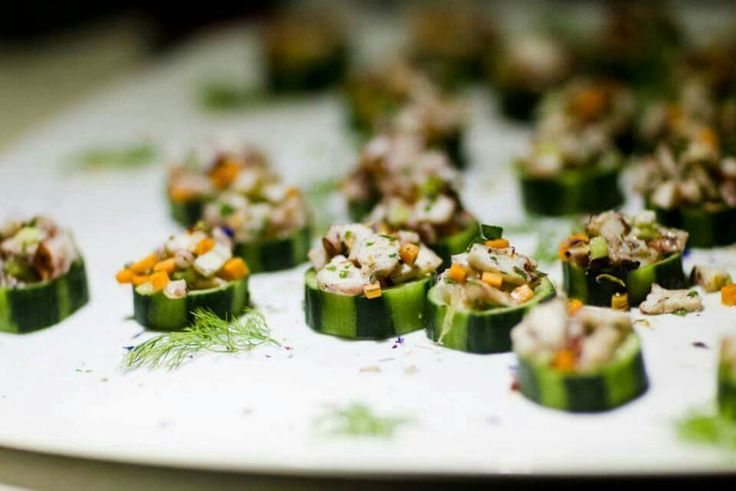#Cucumber #nests, filled with marinated #octopus #bites and #carrot #chops, a very refreshing #fingerfood idea. #Catering #events #santoriniisland #santorini