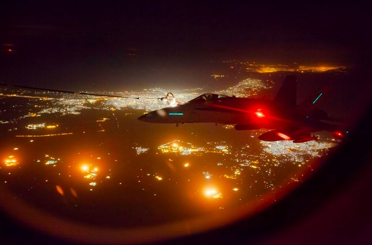 A coalition F/A-18 Hornet refuels from an RAAF KC-30A Multi Role Tanker Transport during an operational sortie.