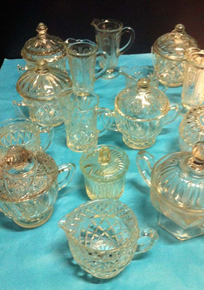 Glass milk jugs and sugar bowls