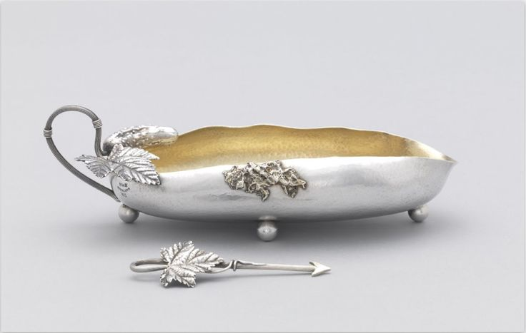 Pickle ca. 1880, the dish is in the form of a cucumber pickle, with gilded interior, with scrolled vine handle flanked by a smaller pickle and leaf, the separate pickle  spear with matching leaf handle. / Cooper Hewitt, Smithsonian Design Museum