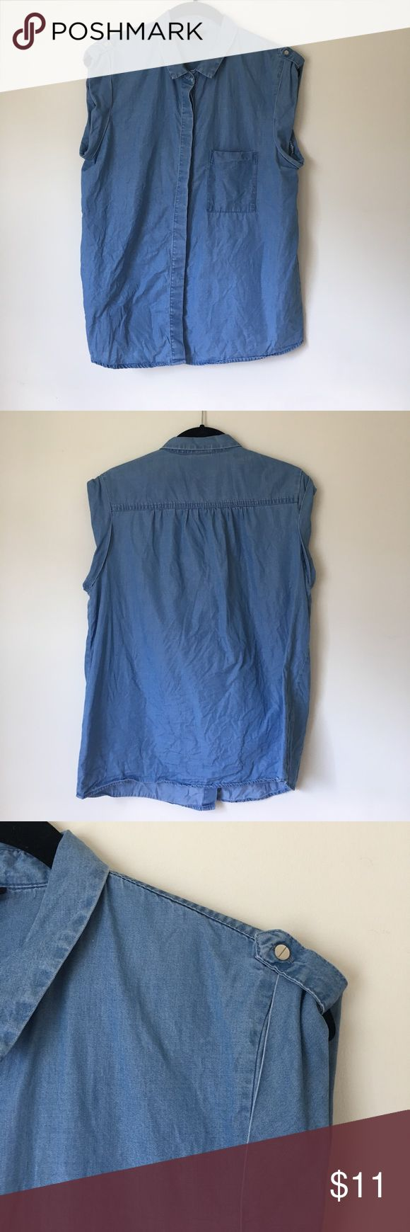 Sleeveless denim shirt Button up denim shirt with pocket and button detailing on shoulder. Great condition! Mossimo Supply Co Tops Button Down Shirts