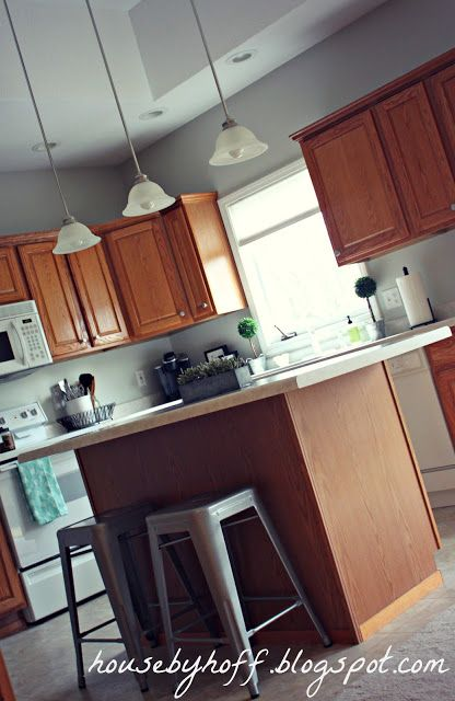 """Design inspiration for kitchen with oak cabinets. Like the paint color-Benjamin Moore's """"Vapor Trails""""."""