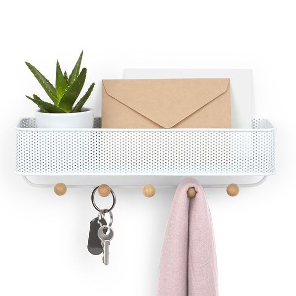 Umbra Estique Hallway Organiser - Add a contemporary storage solution to your entrance hall with the Umbra Estique Hallway Organiser! This glorious multi-purpose design is a key holder, letter tray and storage caddy all at once. The Estique comprises a perforated metal caddy with a row of small wooden ball hooks running underneath. The caddy can hold anything from post to wallets, and can also display a cheerful houseplant, as shown in the image.