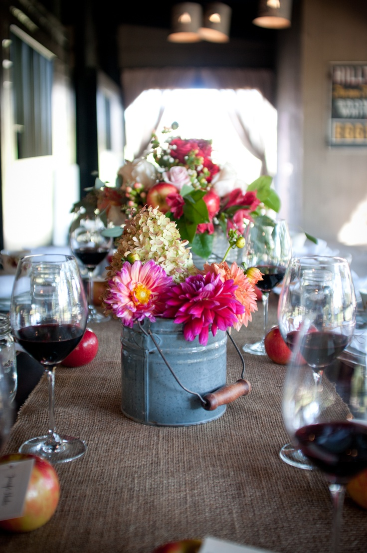 Rustic centerpiece with burlap and tin buckets