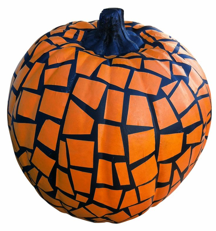 Cut up pieces of masking tape, stick them on your pumpkin, spray paint your pumpkin black. Let dry, then peel the masking tape off and you have a mosaic pumpkin! ~ Let the boys make their own designs- way better than carving!