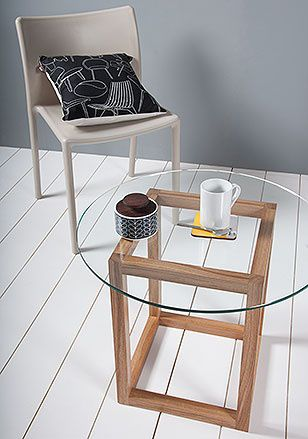 Our 'Cube' coffee table is a simple but very stylish piece of furniture. It has a solid oak cuboid base structure and a 8mm toughtened circular glass polished edge top, which simply rests on the surface of the wood with the aid of discreet, tiny, clear pads. The transparency of the glass top allows the cube structure to be seen from all angles, making this stylish coffee table a unique and understated piece of furniture design and a stunning addition to any contemporary home. Wood op...