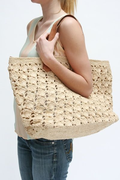 """Made by hand using natural materials sourced sustainably from Madagascar's precious forests. The sale of these bags enables families to gain economic independence and promotes environmental conservation. This is achieved through fair trade partnerships with artisans who make a living wage through our """"trade not aid"""" business model."""