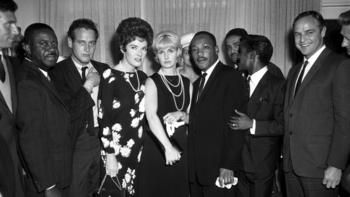 Martin Luther King(center), with Ralph Abernathy(far left), Paul Newman(hand in jacket), Joanne Woodward(Paul's wife-blonde), Sammy Davis Jr.(next to Dr. King with hand on King's arm) and Marlon Brando-during his 1963 visit to Los Angeles for civil rights rally. Polly Bergen next to Joanne. Photo by Harry Adams.
