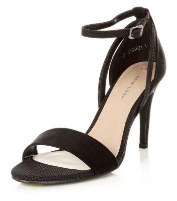 - Buckle fastening- Open toe- Stiletto heel- Ankle strap