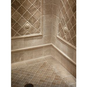 "Idea for shower tile design.  Mosaic 2"" Noce on the shower floor with 6"" Chiaro border and with 4"" Noce tumbled marble inset on walls."