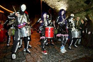 Musical band dressed as skeletons. The origin of Halloween: http://www.irish-genealogy-toolkit.com/origin-of-Halloween.html