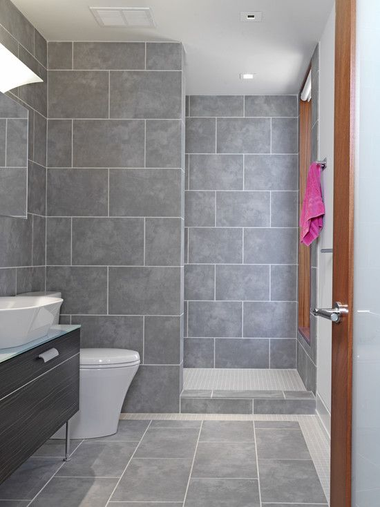 A house we are considering as open tiled showers similar to this.  The tile is brown (not gray) and it (thankfully) has no window right there at the shower!  I love the idea of an open tiled shower!  No glass to keep clean, no curtain driving you crazy!
