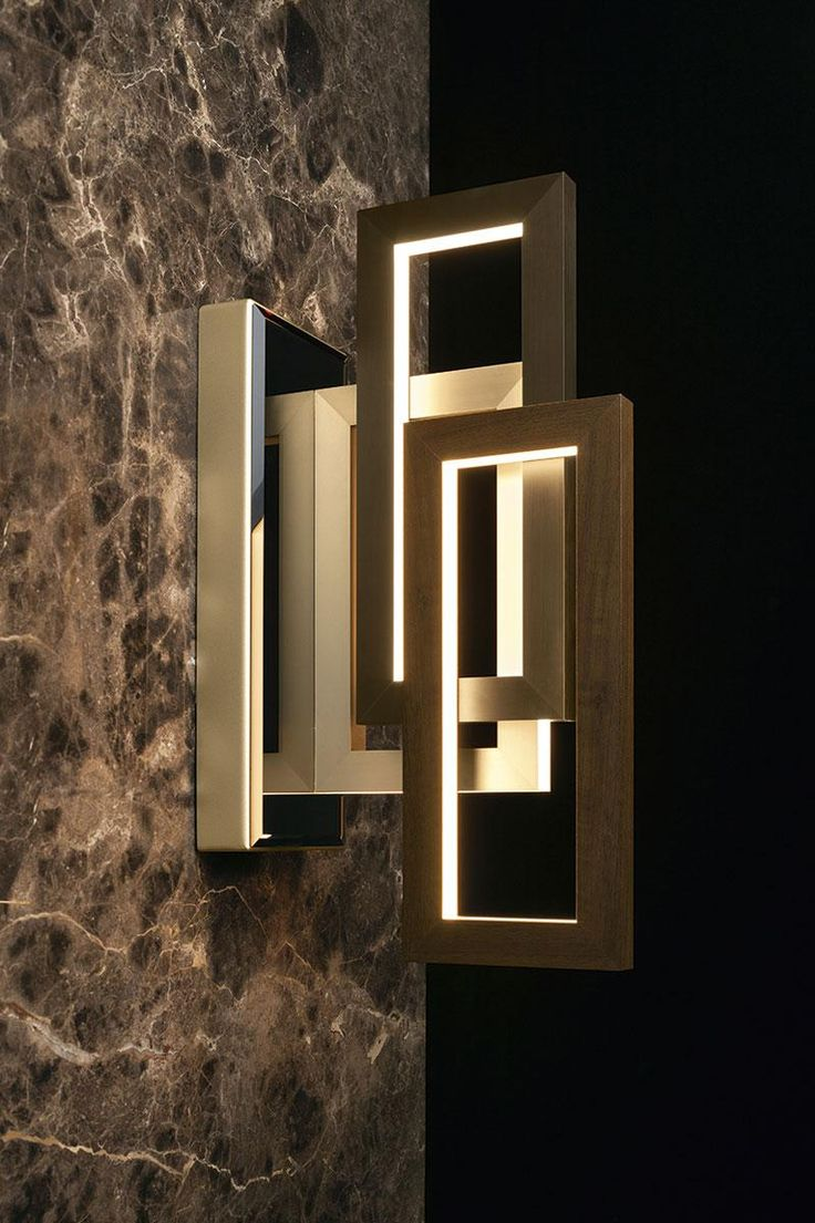 Edge applique lamp by Oasis, design by Massimiliano Raggi. LED lights diffused by a structure of aluminum, bronze and antiqued gold.