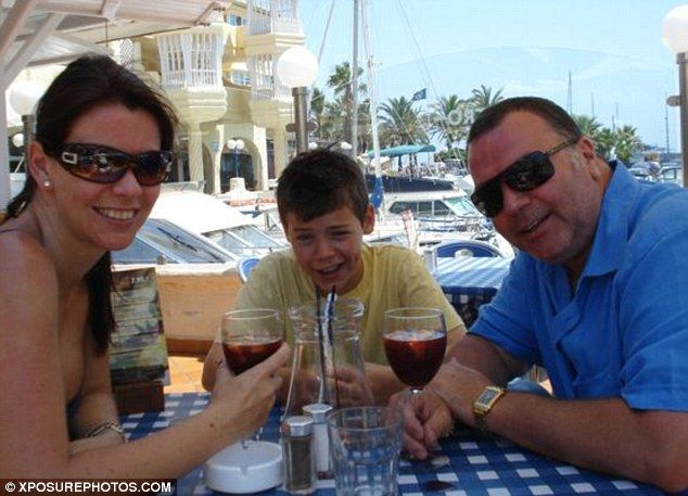 Happy family: A young Harry Styles relaxes with his mum Anne Cox and stepdad Robin Twist